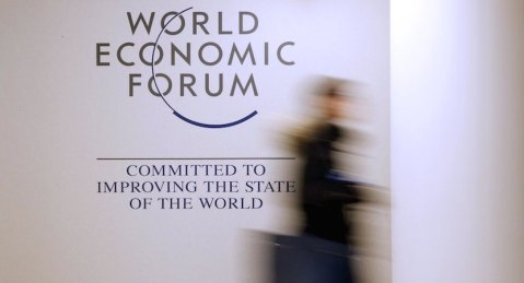 A person passes by a logo of the World Economic Forum (WEF) in the congress centre ahead of the Annual Meeting 2016 of the WEF in Davos, Switzerland